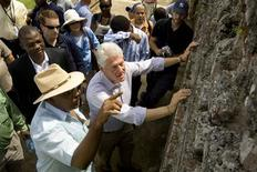 <p>U.N. special envoy to Haiti and former U.S. President Bill Clinton (C) speaks with a local businessman as he visits the ruins of Sans Souci palace near the northern city of Cap Haitian during his two day trip to promote tourism and industry in Haiti in this October 2, 2009 file photo. REUTERS/U.N./Logan Abbasi/Handout</p>