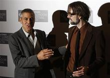 """<p>George Clooney (L) jokes with musician Jarvis Cocker as they arrive to speak about their new film """"Fantastic Mr. Fox"""" in London, October 14, 2009. REUTERS/Luke MacGregor</p>"""