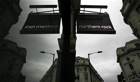 A sign is reflected in the window of a branch of Northern Rock in London August 4, 2009. REUTERS/Luke MacGregor