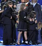 <p>Prince Michael Jackson I (L), Paris Jackson and Prince Michael Jackson II, the children of the late pop star Michael Jackson, walk off stage during the memorial service for Michael Jackson at the Staples Center in Los Angeles, Tuesday, July 7, 2009. REUTERS/Mark J. Terrill/Pool</p>