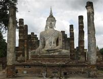 <p>A general view of a Buddha statue is seen at the Sukhothai historical park in Sukhothai September 17, 2009. Picture taken September 17, 2009. To match Travel Postcard-48 Hours in Phitsanulok, Thailand. REUTERS/Ajay Kamalakaran</p>