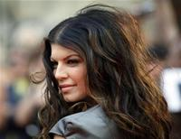 <p>Singer Fergie of the Black Eyed Peas poses on the red carpet during the 2009 MuchMusic Video Awards in Toronto in this June 21, 2009 file photo. REUTERS/Mark Blinch</p>