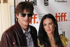 """<p>Demi Moore and her husband Ashton Kutcher arrive at the """"The Joneses"""" film screening during the 34th Toronto International Film Festival, September 13, 2009. The festival runs from September 10-19. REUTERS/Mark Blinch</p>"""