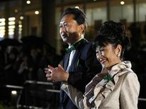 <p>Japan's Prime Minister Yukio Hatoyama (L) and his wife Miyuki pose as they arrive for the opening ceremony of the Tokyo International Film Festival October 17, 2009. REUTERS/Toru Hanai</p>