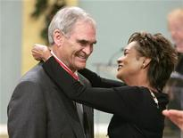 "<p>John ""Jack"" Poole (L), chair of the Vancouver 2010 Olympic Winter Games organizing committee, is awarded the rank of Officer in the Order of Canada by Governor General Michaelle Jean at Rideau Hall in Ottawa December 15, 2006. REUTERS/Chris Wattie</p>"
