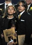 <p>Michael Jackson's children Paris Jackson (L), Prince Michael Jackson II (also known as Blanket) and Prince Michael Jackson I appear onstage at a memorial service for their father at the Staples Center in Los Angeles, California, July 7, 2009. REUTERS/Gabriel Bouys/Pool</p>
