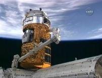 <p>Вид на МКС с пристыкованным японским модулем HTV 17 сентября 2009 года. Компания, планирующая создать первый в мире отель в космосе, заявляет, что он будет готов принять первых гостей уже в 2012 году. REUTERS/NASA TV</p>