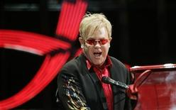 """<p>British singer Elton John performs during a concert as part of his """"The Red Piano"""" tour at Palau Sant Jordi in Barcelona October 20, 2009 REUTERS/Marti Fradera</p>"""