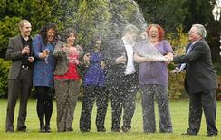 <p>Members of a syndicate that won a share of the EuroMillions lottery spray champagne following a news conference in Liverpool, northern England, November 10, 2009. Sean Connor (L-R), Emma Cartwright, Ceri Scullion, Alex Parry, James Bennett, Donna Rhodes and John Walsh will share the lottery prize, worth 91 million pounds ($153 million), with a couple from south Wales. REUTERS/Phil Noble</p>