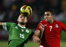 <p>Egypt's Ahmed Fathy (R) challenges Algeria's Karim Ziani during their World Cup 2010 qualifying match, November 14, 2009. REUTERS/Goran Tomasevic</p>