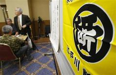 """<p>Attendants are seen next to a sign at a Tokyo branch meeting for alcoholics self-help group """"All Nippon Abstinence Association"""" in Tokyo, November 7, 2009. REUTERS/Kim Kyung-Hoon</p>"""