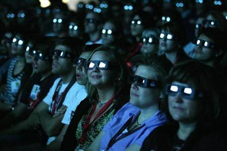 Visitors wear 3D glasses as they watch a preview of the upcoming movie ''Avatar'' during the 40th annual Comic Con Convention in San Diego July 23, 2009. The convention runs July 23-26. REUTERS/Mario Anzuoni