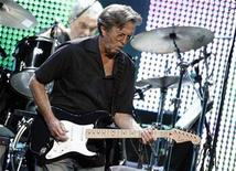 <p>Singer songwriter Eric Clapton performs at the Albert Hall in London in this May 16, 2009 file photo. REUTERS/Luke MacGregor</p>