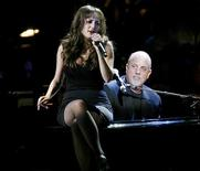 <p>Singer Billy Joel and his daughter Alexa Ray Joel perform during the Rainforest Foundation Benefit Concert in New York, in this May 8, 2008 file photo. REUTERS/Keith Bedford/Files</p>
