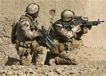 <p>Canadian soldiers keep watch during a joint foot patrol with U.S. and Afghan National army in Arghandab district, Kandahar province October 31, 2009. REUTERS/ Omar Sobhani</p>