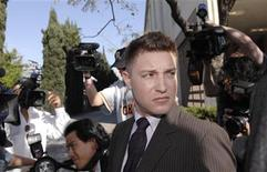 <p>Actor Lane Garrison leaves the Beverly Hills Superior Court in Beverly Hills, California March 8, 2007. REUTERS/Phil McCarten</p>