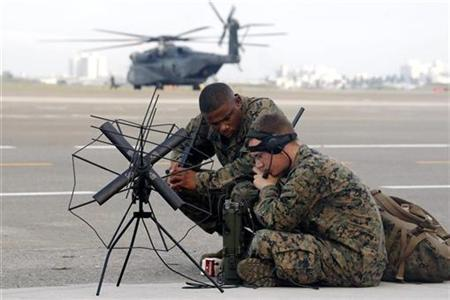 U.S. military personnel set up communication equipment in front of a MH-53E Sea Dragon helicopter at Tainan air force base in southern Taiwan August 18, 2009. REUTERS/Taiwan Military News Agency/Handout