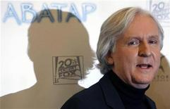 "<p>Canadian director James Cameron poses for the media to promote his latest movie ""Avatar"" in Moscow December 9, 2009. REUTERS/Denis Sinyakov</p>"
