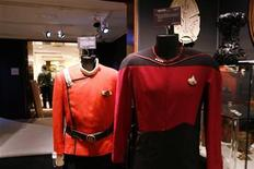 """<p>Uniforms used as a props from the television series """"Star Trek"""" sit on display during a preview of the auction """"40 Years of Star Trek: The Collection"""" at Christie's auction house in New York, September 29, 2006. REUTERS/Keith Bedford</p>"""