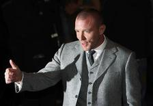"<p>British director Guy Ritchie arrives for the world premiere of ""Sherlock Holmes"" in Leicester Square in London December 14, 2009. REUTERS/Suzanne Plunkett</p>"