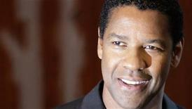 <p>Denzel Washington poses during a photocall to promote his latest film 'The Taking of Pelham 123' in Berlin, July 21, 2009. The movie opens in German cinemas September 24. REUTERS/Tobias Schwarz</p>
