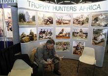 <p>A vendor flips through a brochure as he waits for customers at the annual Dallas Safari Club Convention in Dallas, Texas in this January 10, 2009 file photo. REUTERS/Jessica Rinaldi/Files</p>