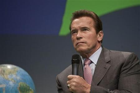 Arnold Schwarzenegger, governor of the state of California, listens to a question during a debate at the Climate Summit for Mayors at the Copenhagen City Hall December 16, 2009. REUTERS/Scanpix/Anders Debel Hansen
