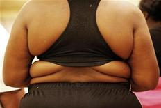 """<p>A competitor prepares to go in front of judges at a casting call for the second season of the reality television programme """"Dance Your Ass Off"""", during which overweight or obese contestants hope to lose weight by dancing, in New York December 18, 2009. REUTERS/Finbarr O'Reilly</p>"""