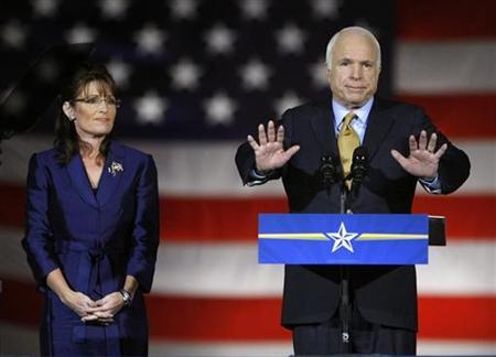 Republican presidential nominee Senator John McCain (R-AZ) speaks to the crowd during his election night rally in Phoenix in this November 4, 2008 file photo. Joining McCain is then Republican vice presidential nominee Alaska Gov. Sarah Palin. REUTERS/Mike Blake