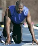 <p>Sprinter Justin Gatlin prepares to run from the blocks during practice in Marietta, Georgia January 18, 2010. Former Olympic and world champion Gatlin warned kingpins Usain Bolt and Tyson Gay to brace for a possible defeat when the U.S. sprinter returns from a four-year doping suspension this year. REUTERS/Tami Chappell</p>