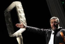 <p>French designer Philippe Starck gestures during a news conference to present a new line of Micro Wind Turbines in downtown Milan January 27, 2010. REUTERS/Alessandro Garofalo</p>