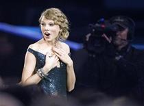 """<p>Taylor Swift reacts after winning best country album for """"Fearless"""" at the 52nd annual Grammy Awards in Los Angeles January 31, 2010. REUTERS/Mike Blake</p>"""