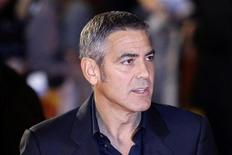"""<p>U.S. actor George Clooney poses for photographers as he arrives for the gala screening of the film """"The men who stare at goats"""" in Leicester Square, London October 15, 2009. REUTERS/Stefan Wermuth</p>"""
