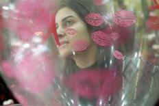 <p>A vendor arranges balloons for Valentine's Day at a shop in Beirut, February 12, 2010. REUTERS/Cynthia Karam</p>