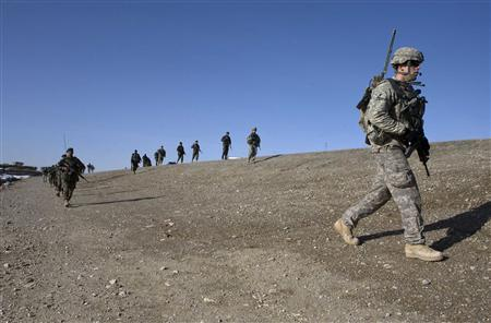 U.S. Army Private First Class Nick Banta from Jenison, Michigan, and Alpha Company, 4th Brigade combat team, 1-508, 82nd Parachute Infantry Regiment walks on a patrol with Afghan National Army soldiers in the town of Shah joy in Zabul province, southern Afghanistan, February 12, 2010. REUTERS/Baz Ratner