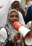 <p>Sudanese students shout using a public address system during a demonstration in the streets of the Sudanese capital of Khartoum April 2, 2005. REUTERS</p>