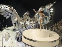 <p>Revellers of the Portela samba school participate in the second night of the Carnival parade in Rio de Janeiro's Sambadrome, February 15, 2010. REUTERS/Sergio Moraes</p>