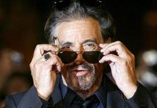 "<p>U.S. actor and director Al Pacino gestures on the red carpet as he arrives for his movie ""Chinese Coffee"" at Rome's Film Festival October 22, 2008. REUTERS/Dario Pignatelli</p>"