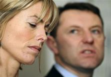<p>Kate and Gerry McCann speak about the disappearance of their daughter Madeleine, at a news conference in London February 19, 2010. REUTERS/Jas Lehal</p>