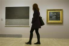 """<p>A woman walks past Claude Monet's """"Marine, effet de nuit"""" (R) and Mark Rothko's """"Untitled"""" during the media inauguration of the exhibit """"Monet and the Abstraction"""" at Madrid's Thyssen-Bornemisza museum February 18, 2010. REUTERS/Andrea Comas</p>"""