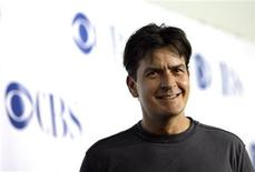 "<p>Actor Charlie Sheen smiles at the CBS summer press tour party at the Rose Bowl in Pasadena, California, July 15, 2006. Sheen stars in the CBS sit-com ""Two and a Half Men"". REUTERS/Mario Anzuoni</p>"