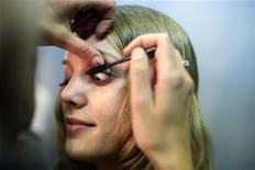 <p>A model gets ready before presenting a creation at the Reem Acra Spring 2010 collection during New York Fashion Week September 13, 2009. REUTERS/Kena Betancur</p>