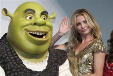 """<p>Actress Cameron Diaz poses with a person dressed as Shrek at the premiere of """"Shrek the Third"""" in Tokyo May 28, 2007. REUTERS/Issei Kato</p>"""