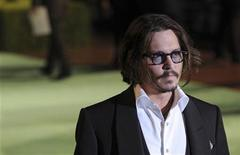 "<p>Johnny Depp poses for photographers as he arrives for the Royal World Premiere of ""Alice In Wonderland"" at Leicester Square in London February 25, 2010. REUTERS/Jas Lehal</p>"