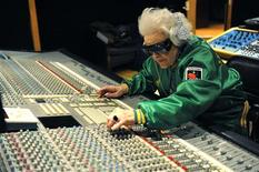 <p>British DJ Ruth Flowers, 69 year-old, mixes music at a recording studio in Paris March 3, 2010. REUTERS/Philippe Wojazer</p>