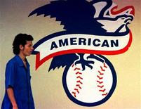 <p>In this file photo an employee of the Rawling baseball factory walks in front of the logo of the American League in Turrialba, 40 miles southeast of the capital San Jose, May 22, 2000. REUTERS/Juan Carlos Ulate</p>