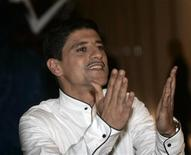 <p>French actor Said Taghmaoui gestures to photographers at the Marrakesh 9th International Film Festival December 5, 2009. REUTERS/Jean Blondin</p>