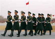 <p>Paramilitary policemen march on Tiananmen Square ahead of the closing ceremony for the Chinese People's Political Consultative Conference during the National People's Congress (NPC), in Beijing March 13, 2010. REUTERS/David Gray</p>