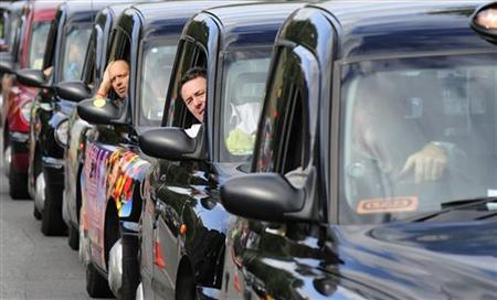 London taxi drivers queue during a protest in central London September 10, 2009. REUTERS/Toby Melville