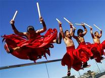 <p>Performers from Japanese drumming troupe Tao perform during a media event ahead of their forthcoming show at the Edinburgh International Festival in Edinburgh, Scotland August 7, 2009. REUTERS/David Moir</p>